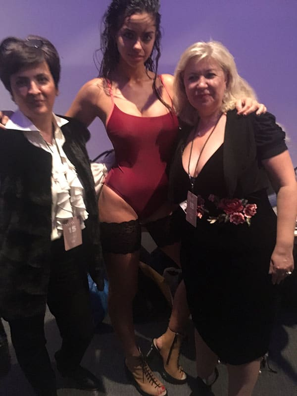 Bandelettes founders pose with model at NYFW