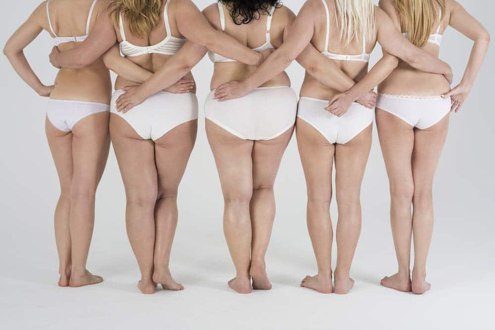 Woman of different shapes standing in row