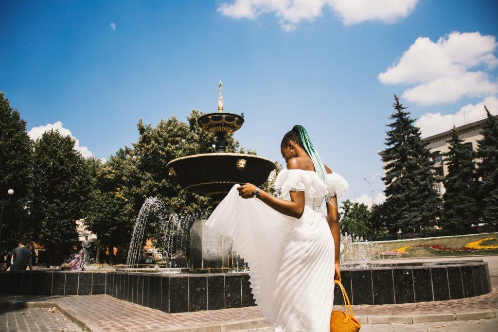 Woman Wearing White Pleated Dress